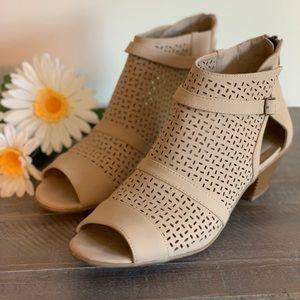 Tan heeled sandals with zip up heel.
